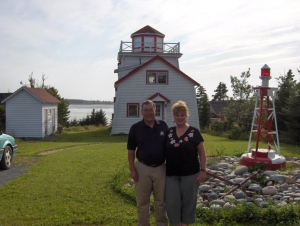 Barry and Anne Marie in front of their lighthouse.