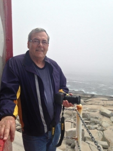Barry MacDonald on the gallery of Peggy's Cove Lighthouse, photo by Natalie Buff, National Trust for Canada