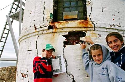 Lighthouse Kids inspect damage to lighthouse