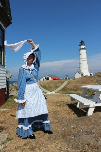 Keeper Sally Snowman waving a welcome at Boston Light