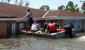 boat rescuing people from roof