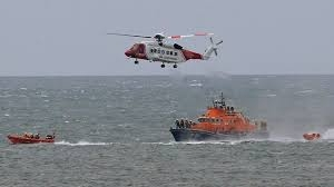 two boats and a helicopter